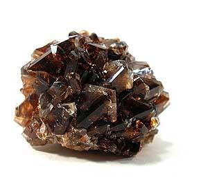 Colemanite, 2.4 x 3 x 4 cm.  Mustafakemalpascha mine, Western Anatolia Province, Turkey.  irocks.com/Arkenstone specimen; Meg Foreman photo